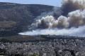 Požiar severne od Atén vyčíňa už štvrtý deň